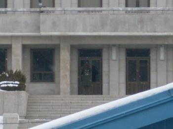 North Korean soldier peeking at us through binoculaurs