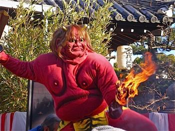 A Setsubun Devil arrives with sword and torch at a Japanese Temple