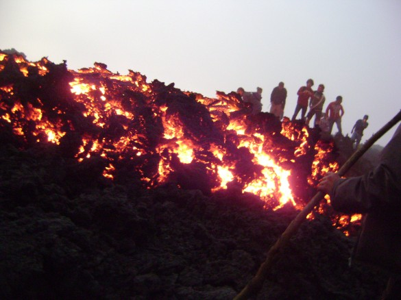 Hikers looking at the lava