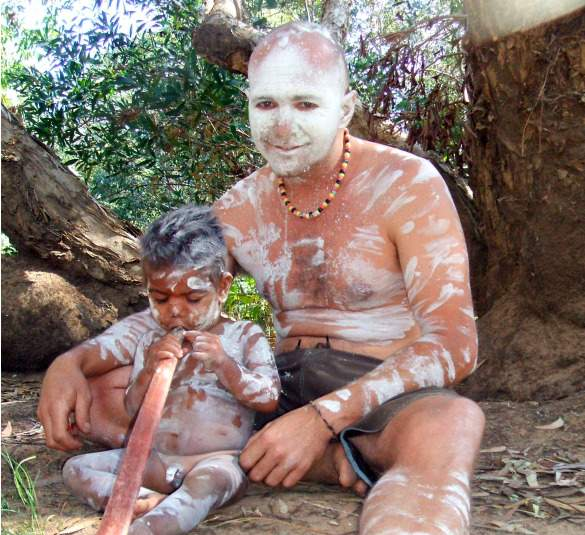Sam wearing traditional body paint with one of his cousins of the Jawoyn People