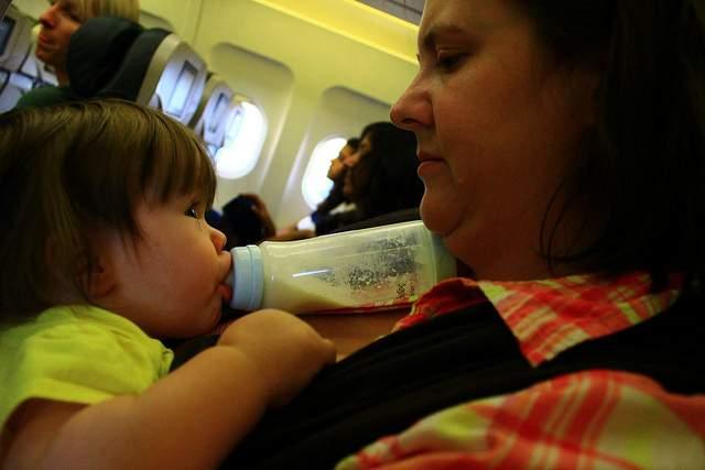 Feeding baby on a plane