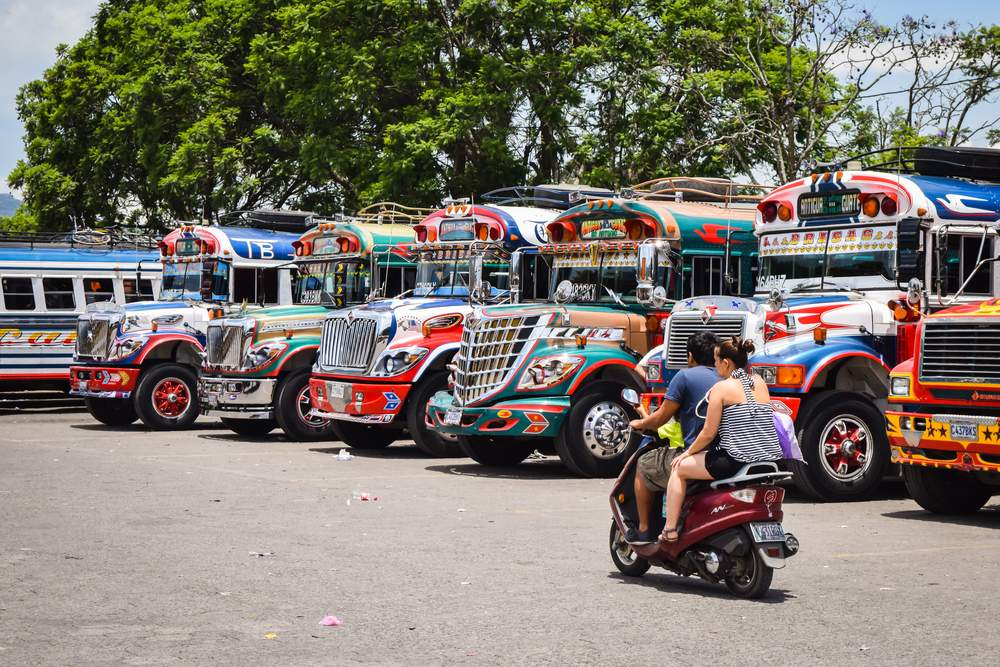 chicken bus and motor bike in Antiga, Guatemala