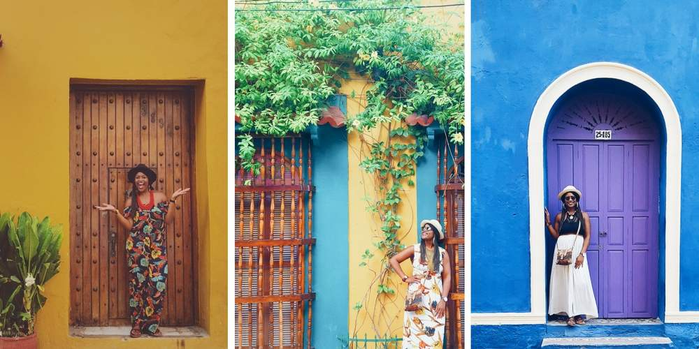 Gloria Atanmo poses for pictures against the colorful walls of Cartagena's old town