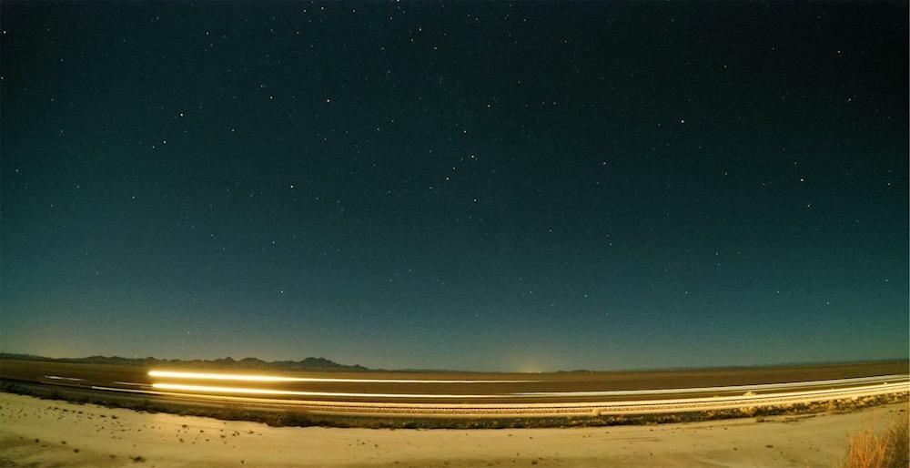 Train passing under my favorite constellation around 9pm in the desert